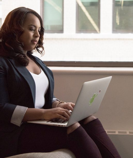 african-american-woman-with-laptop_equality_programmer_devops_leader-by-christina-morillo-100764669-large